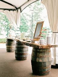 view in gallery wine barrels used to hold up the dessert table at a wedding