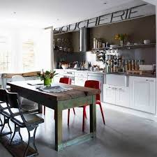 industrial kitchen furniture. Timeless White Kitchen Cabinets Combined With Red Chairs And A Weathered Barn-like Dining Table Industrial Furniture H
