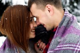 cute couple kissing snow