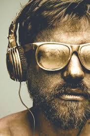 bearded man wearing black plastic framed sungles with headset hd wallpaper