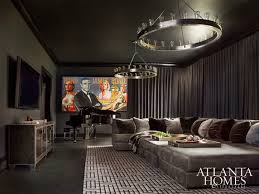 this a room evokes masculinity with the chandeliers from circa lighting and james bond pop