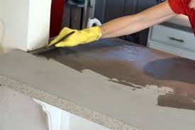applying the second layer of the feather finish concrete to the countertop