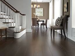 dark laminate wood flooring. Delighful Wood Dark Laminate Wood Flooring Wrapped Around This  Staircase BOUUEGS Intended Dark Laminate Wood Flooring U