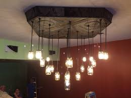 picture of antique ceiling tin and mason jars chandeliers