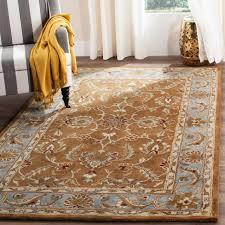 safavieh handmade heritage timeless traditional brown blue wool rug 7 6 x 9