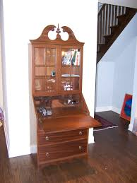 vintage brown wooden antique secretary desk with hutch