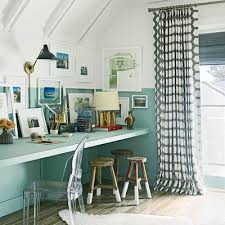 cottage office. The Narrow Built-in Desk In This Upstairs Study Leaves Plenty Of Room For A Foldaway Daybed, Making Space An Office By Day And Guest Night. Cottage