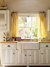 yellow window curtains with rustic ceiling texture for farmhouse kitchen ideas with grey and white striped cabinet doors