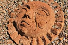 geology design handmade clay ornamental carving anthropomorphic sun face amber avalona xeriscape yard art outdoor art xeriscaping southwest
