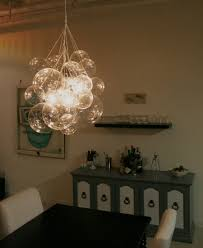 unique hanging clear bubble chandelier over the dining room table