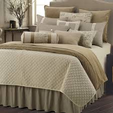 bedroom quilted bedspreads with brown wooden floor and standing