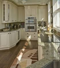 Glass Countertops White Kitchen Cabinets With Dark Floors Lighting