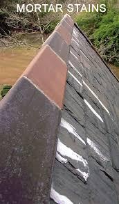 installing ceramic ridge tile on a slate roof using flexim