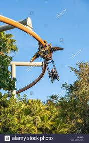 flyers orlando father and son riding the pteranodon flyers ride in jurassic park at