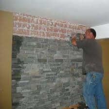 refacing brick fireplace with stone veneer stone veneer over existing ugly brick on your fireplace refacing refacing brick fireplace with stone