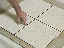 for floor installations some tile contractors we know will actually pour dry grout over small areas of the floor sweep it off the surface and get a sense