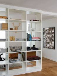 a large white shelving unit is a very flexible tool to separate the spaces with comfort