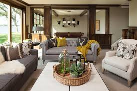 exle of a clic carpeted family room design in minneapolis with beige walls