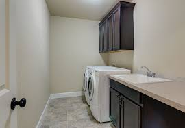 Elegant Laundry Room With Bruce Pathways Grand Coral Sand Laminate Flooring Awesome Design