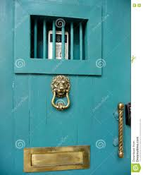 Turquoise front door Taupe Siding Turquoise Front Door With Lion Head Knocker Reiko Design Turquoise Front Door With Lion Head Knocker Stock Image Image Of