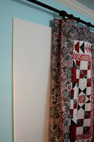 Hang quilt over design wall from curtain rod with clips ... & Hang quilt over design wall from curtain rod with clips! ❤ Adamdwight.com