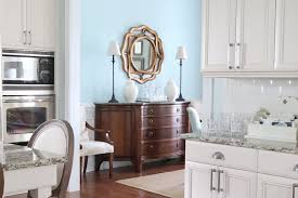 yes you can use chalk paint over stain