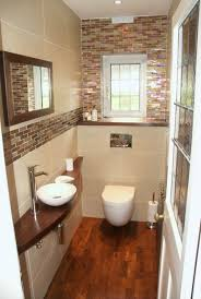 Pretty little cloakroom but wouldn't have wood in a bathroom again.  Difficult to