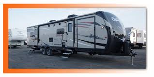 outback 324cg the 2017 keystone outback 324cg toy hauler travel trailer has everything you need to e spending quality time with family and a few