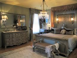 lavish silver bedroom with chandelier