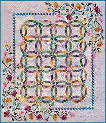 Best 25+ Wedding ring quilt ideas on Pinterest | DIY wedding ring ... & As we continue our coverage of wedding ring quilts, today we& bringing you  some beautiful double wedding ring patterns by Judy Niemeyer Qu. Adamdwight.com