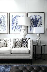 wall art above sofa art behind sofa living room beach style with traditional table lamp tufted