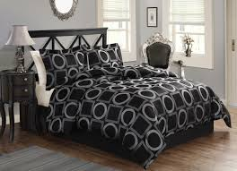 elegant bedroom design with modern comforter sets and upholstered headboard  plus cozy lowes wood flooring