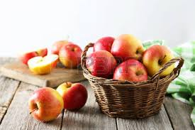 green and red apples in basket. green apple board: red apples in basket on grey wooden background and k
