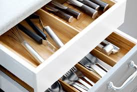 Plan your IKEA Kitchen  Close-up of open drawers with flatware trays in  solid beech.