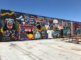 to enlarge murals wrap around the building including this piece by brothers jared and ian jethmal