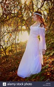 Profile of a pretty young woman wearing a white wedding dress with a