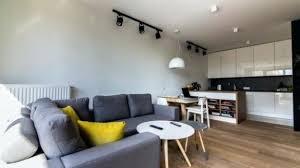 black track lighting. Track Lighting For Living Room Interior Black With Grey Upholstery Regard