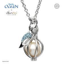 silver mermaid pearl pendant embellished with aquamarine swarovski crystals