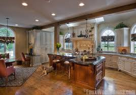 open floor kitchen enhanced with a single ceiling beam and pillar