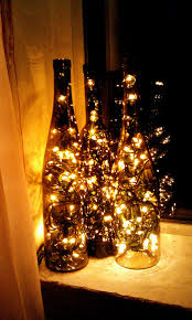 wine lighting. recycle an empty wine bottle by placing christmas lights inside and lighting