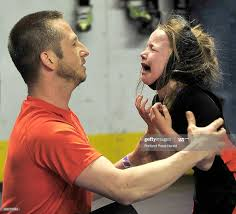 Ava Lewis gets encouragement from her father and coach, Brandon Lewis...  News Photo - Getty Images