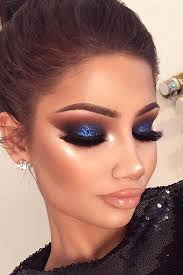 i love that this makeup is quite neutral besides the glitter blue eyeshadow it really makes it stand out what a great look for prom or a party