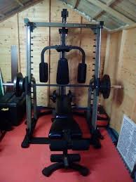 nautilus smith machine and bench plus 100 kg weight plates