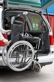 wheelchair lift for car. Two-way Hoist Lifting A Folded Manual Wheelchair Into Car Boot Lift For