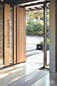 front door inspirations front door design door design a massive pivot door made of oak metal