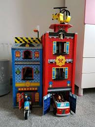 kidkraft everyday heroes wooden playhouse police and fire station