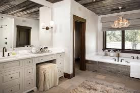 country style bathroom with faux antlers chandelier over plank tub