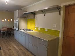 backsplash material yellow glass tile backsplash white manufactured metal cabinet storage unfinished hardwood floor polished marble