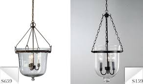 knockout lighting up the table is the clear glass cloche chandelier