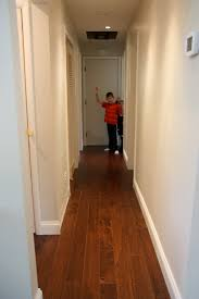 recessed lighting in hallway. recessed lighting was installed to wash the walls and brighten passageway hi boys interior doors were replaced but they arenu0027t painted yet in hallway s